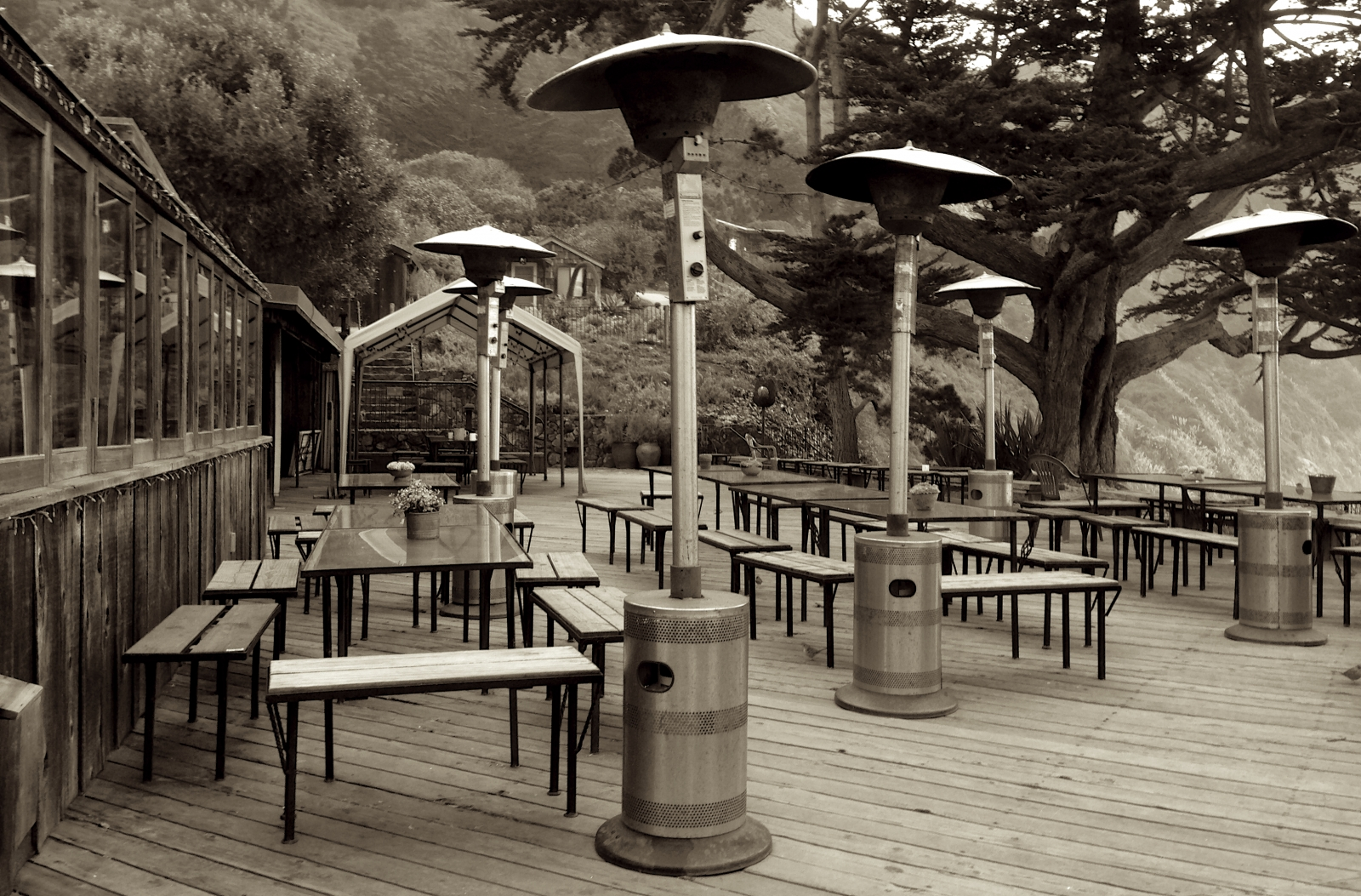 Esalen Sepia lodge deck with hatted heaters.