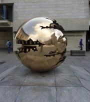 Reflecting broken globe statue. Trinity College. Dublin.