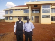 Father Dunstan and Father Hugo in front of New Medical College in Peramiho, Tanzania.